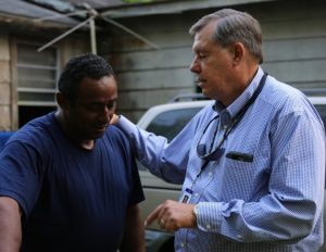 ps burchett prays 2016 flood victim
